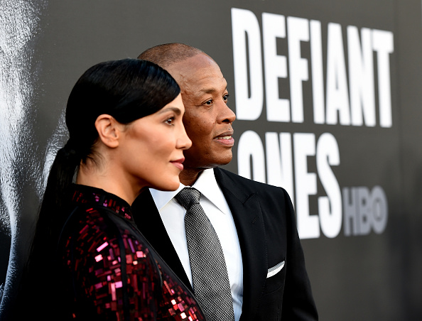 "Nicole Young (L) and producer Dr. Dre arrive at the premiere screening of HBO's ""The Defiant Ones"" at Paramount Studios on June 22, 2017 in Los Angeles, California."