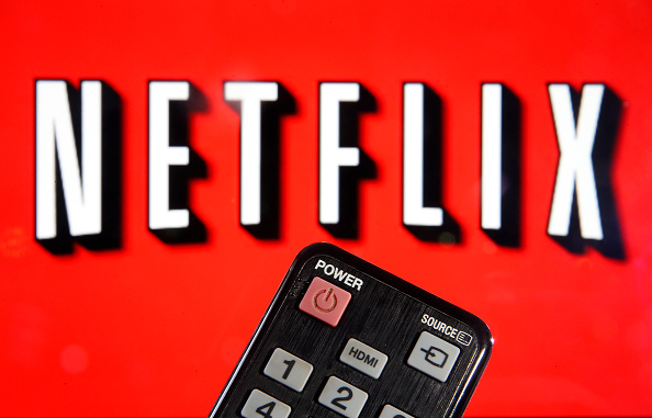 In this photo illustration, a remote control is seen in front of a television screen showing a Netflix logo on March 28, 2020 in Paris, France. Faced with the coronavirus crisis, Netflix will reduce visual quality for the next 30 days, in order to limit its use of bandwidth.
