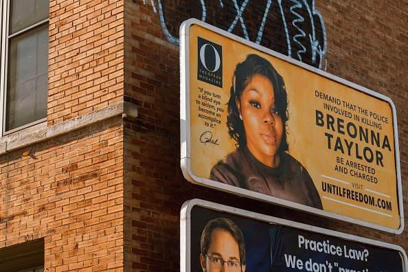 A billboard featuring a picture of Breonna Taylor and calling for the arrest of police officers involved in her death is seen on August 11, 2020 in Louisville, Kentucky. Oprah Winfrey's O Magazine sponsored the campaign featuring 26 billboards, one for every year Taylor was alive, across the city of Louisville where she died. Taylor was killed by Louisville Metro Police Department officers in a no-knock raid on March 13 when gunfire erupted.