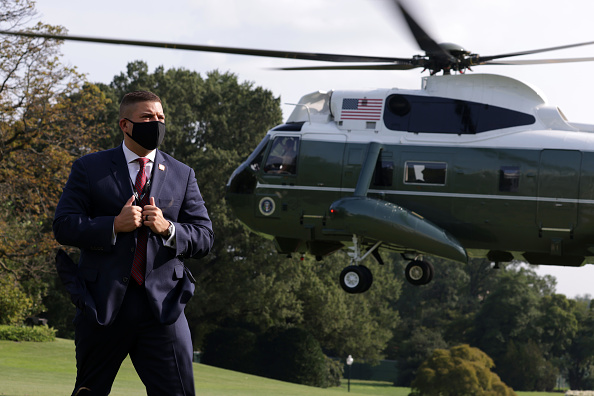 A U.S. Secret Service agent stands guard as Marine One, with U.S. President Donald Trump aboard, takes off from the South Lawn of the White House September 18, 2020 in Washington, DC. President Trump is traveling to Bemidji, Minnesota, to campaign for the upcoming presidential election.