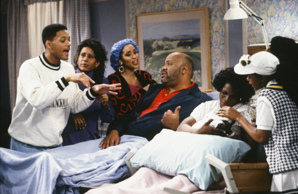 """""""The Baby Comes Out"""" Episode 20 -- Pictured: (l-r) Will Smith as William 'Will' Smith, Vernee Watson-Johnson as Viola 'Vy' Smith, Karyn Parsons as Hilary Banks, James Avery as Philip Banks, Janet Hubert as Vivian Banks, Tatyana Ali as Ashley Banks"""