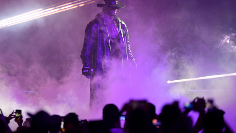 TOPSHOT - World Wrestling Entertainment star The Undertaker makes his way to the ring during a match at the World Wrestling Entertainment (WWE) Super Showdown event in the Saudi Red Sea port city of Jeddah late on January 7, 2019.