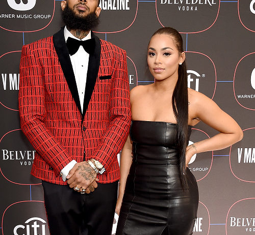 LOS ANGELES, CA - FEBRUARY 07: Nipsey Hussle and Lauren London arrive at the Warner Music Group Pre-Grammy Celebration at Nomad Hotel Los Angeles on February 7, 2019 in Los Angeles, California.