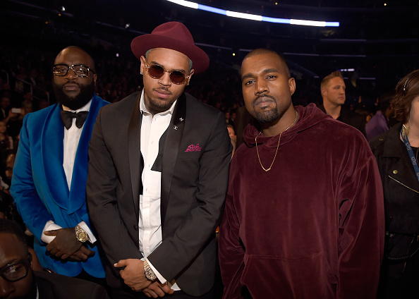 Rapper Rick Ross, recording artist Chris Brown and recording artist Kanye West attend The 57th Annual GRAMMY Awards at STAPLES Center on February 8, 2015 in Los Angeles, California.
