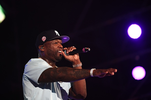US rapper 50 Cent performs on stage during the Jeddah World music Festival on July 18, 2019, at the King Abdullah Sports City in the coastal city of Jeddah. - US Pop icon Janet Jackson and US rapper 50 Cent are among musicians set to perform in Saudi Arabia, organisers said, after US rapper Nicki Minaj pulled out in a show of support for women's rights.