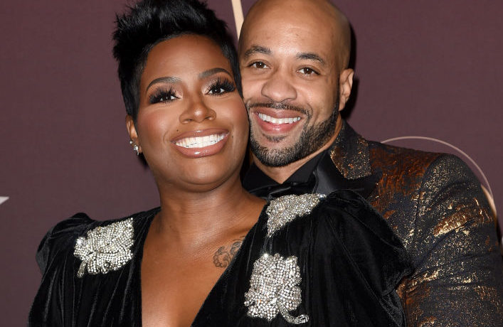 LOS ANGELES, CA - SEPTEMBER 25: Fantasia Barrino (L) and her husband Kendall Taylor arrive at Q85: A Musical Celebration for Quincy Jones at the Microsoft Theatre on September 25, 2018 in Los Angeles, California.