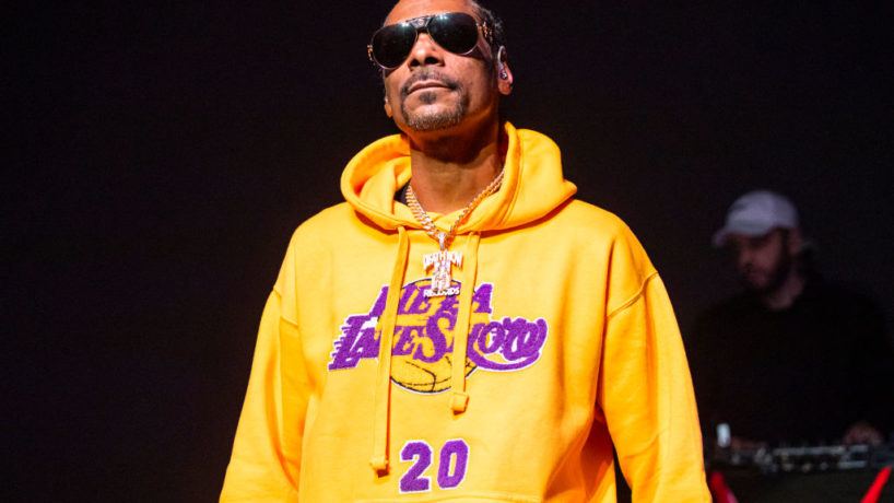 DETROIT, MICHIGAN - JANUARY 26: Snoop Dogg performs, while wearing a Los Angeles Lakers sweat suit in memory of Kobe Bryant, at The Fillmore on January 26, 2020 in Detroit, Michigan. Kobe Bryant died in a helicopter crash on January 26th.