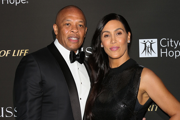 LOS ANGELES, CA - OCTOBER 11: Rapper / Music Producer Dr. Dre (L) and his Wife Nicole Young (R) attend the City Of Hope Gala on October 11, 2018 in Los Angeles, Californa.