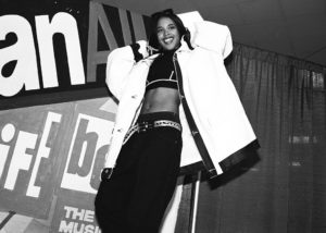 NEW YORK - OCTOBER 5: American R&B singer Aaliyah, aka Aaliyah Dana Houghton (1979-2001) poses for a photo backstage at Madison Square Garden for Lifebeat's Urban Aid benefit concert on October 5, 1995 in New York City, New York.