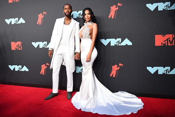 US reality television personalities Safaree Samuels (R) and Erica Mena arrive for the 2019 MTV Video Music Awards at the Prudential Center in Newark, New Jersey on August 26, 2019. (Photo by Johannes EISELE / AFP)