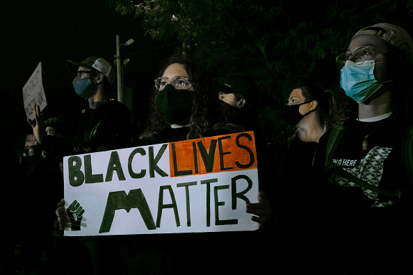 Demonstrators gather in front of the public safety building in protest of the police killing of Daniel Prude on September 8, 2020, in Rochester, New York. This is the seventh consecutive night of protesting since family released bodycam footage of Prude's arrest that led to his subsequent death. Since protesting began, Rochester Mayor Lovely Warren announced the suspension of seven officers involved in the arrest and promises reforms to the city's police department.