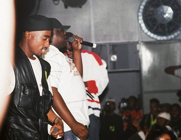Rappers Tupac Shakur, The Notorious B.I.G. aka Biggie Smalls (Christoper Wallace) and Puff Daddy (sean Combes) perform onstage at the Palladium on July 23, 1993 in New York, New York.