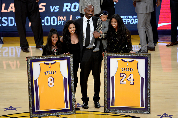 Kobe Bryant poses with his family at halftime after both his #8 and #24 Los Angeles Lakers jerseys are retired at Staples Center on December 18, 2017 in Los Angeles, California. NOTE TO USER: User expressly acknowledges and agrees that, by downloading and or using this photograph, User is consenting to the terms and conditions of the Getty Images License Agreement.