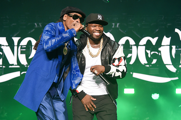 """NEW YORK, NEW YORK - AUGUST 20: Snoop Dogg (L) and Curtis """"50 Cent"""" Jackson perform onstage at STARZ Madison Square Garden """"Power"""" Season 6 Red Carpet Premiere, Concert, and Party on August 20, 2019 in New York City."""