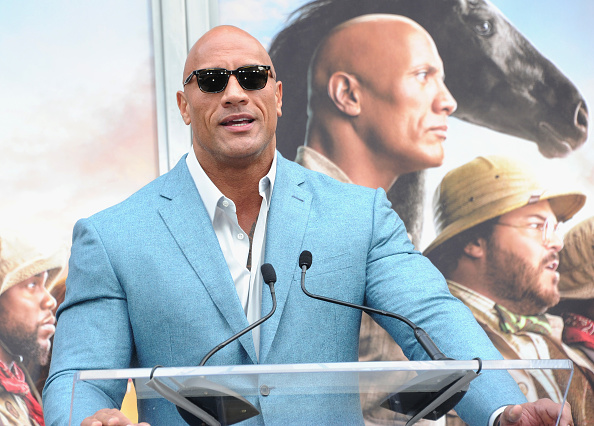 HOLLYWOOD, CA - DECEMBER 10: Dwayne Johnson speaks at Kevin Hart's Hand And Footprint Ceremony At the TCL Chinese Theatre IMAX held at TCL Chinese Theatre on December 10, 2019 in Hollywood, California.