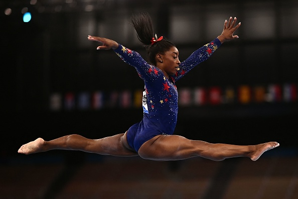 TOPSHOT - USA's Simone Biles competes in the artistic gymnastics balance beam event of the women's qualification during the Tokyo 2020 Olympic Games at the Ariake Gymnastics Centre in Tokyo on July 25, 2021.