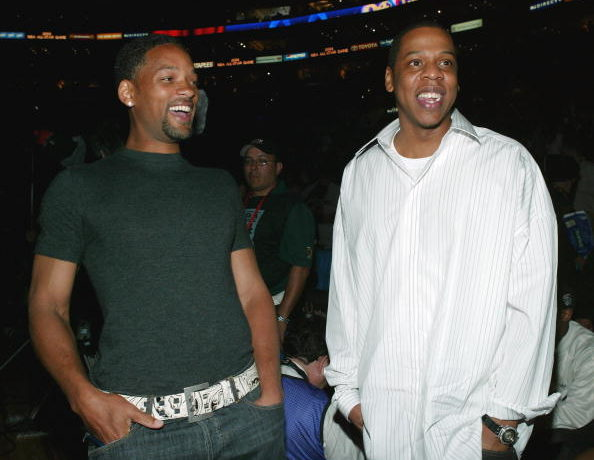 (L-R) Actor Will Smith and rap artist Jay Z attend the 2004 NBA All-Star Game held at the Staples Center, February 15, 2004 in Los Angeles, California.