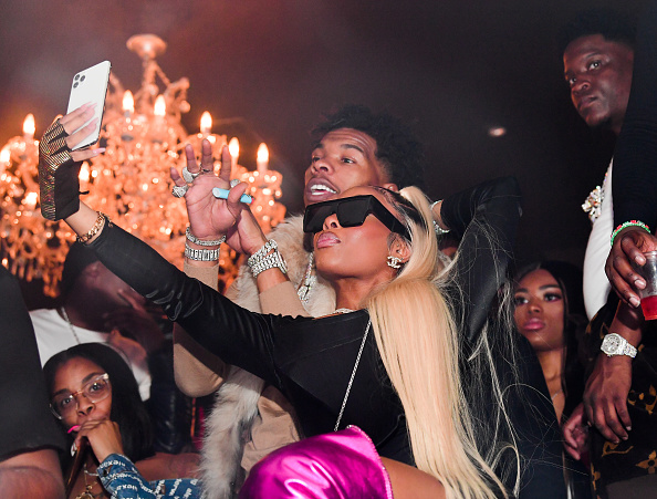 Rapper Lil Baby and Jayda Cheaves attend the Official Fight After Party at Compound on December 29, 2019 in Atlanta, Georgia.