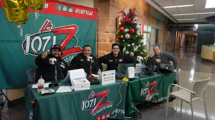 La Z staff speaking on mics during radiothon