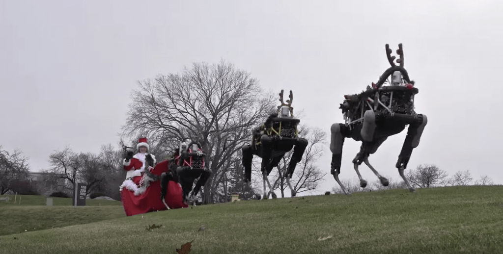 Lady riding sleigh with robot reindeer