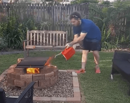 Man Pours Gas on a Fire