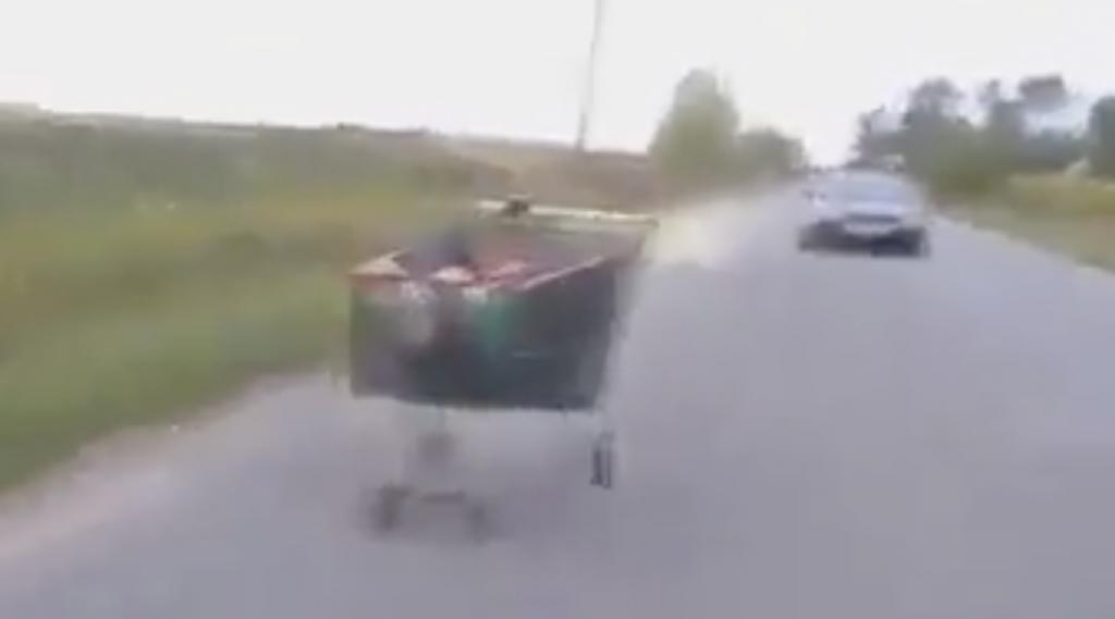 guy in shopping cart