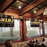 Dudley and Bob with Matt Breaking & Entering 2019: KLBJ signage at Rudy's Country Store and BBQ