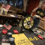 Emily holding down the KLBJ FM swag table: Emily holding down the KLBJ FM swag table