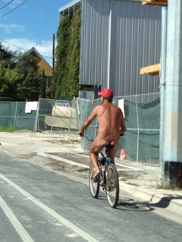 nude man on bike