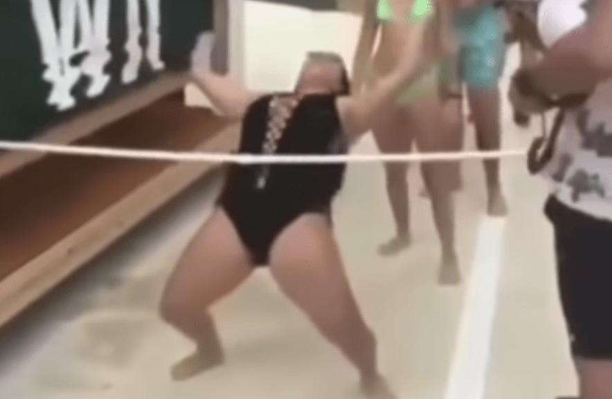 womens bikini rips while limbo