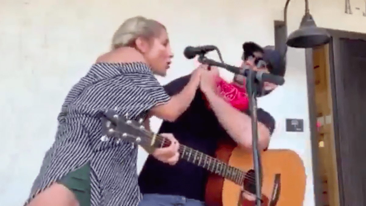 woman coughing on guitar player