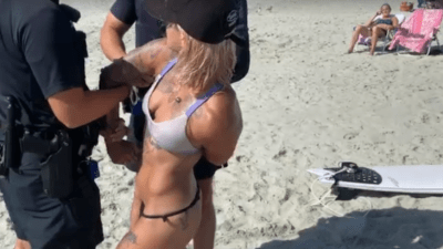 Bikini Babe Detained for Wearing Thong