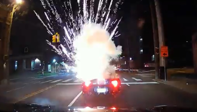 Firework Tossed in Convertible