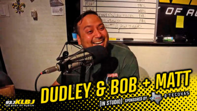 Chuy laughing in the KLBJ FM studio.