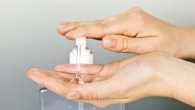 individual using hand sanitizer