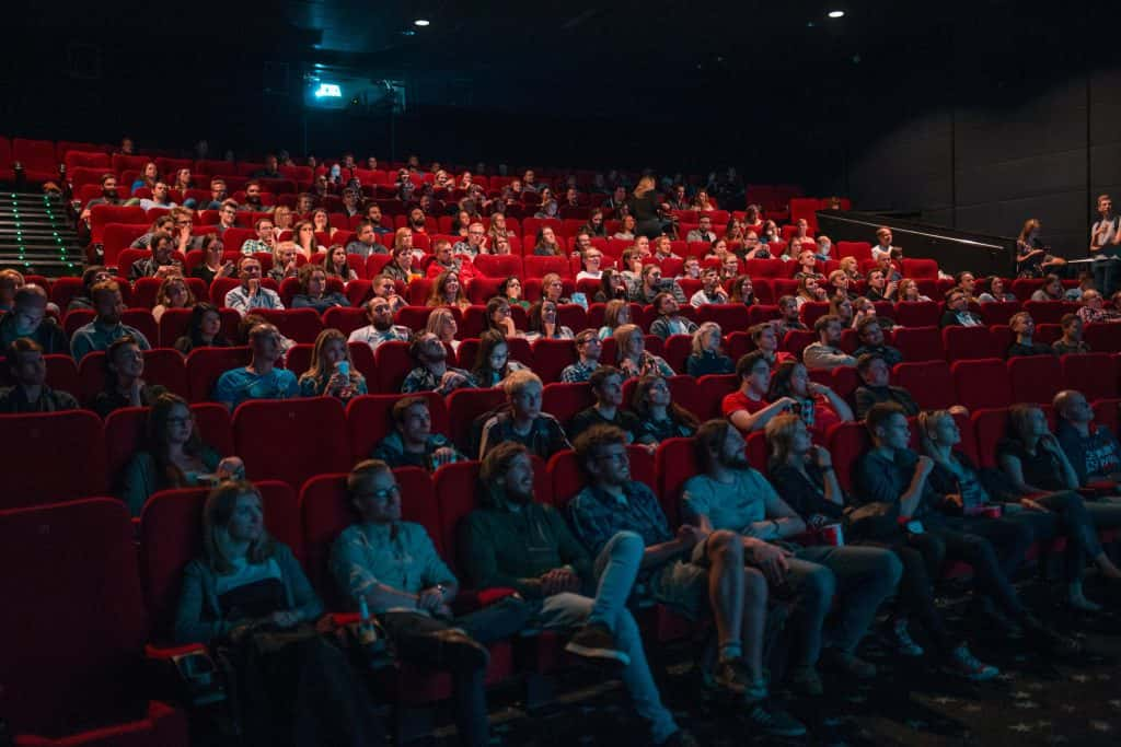 people sitting at movie theater