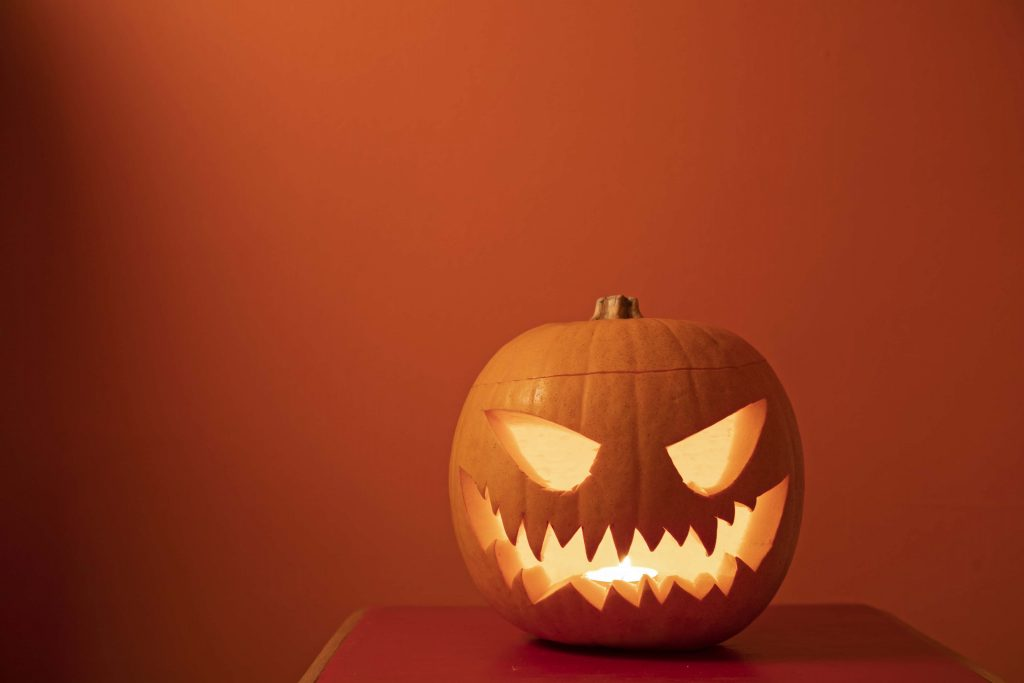 Pumpkin with scary carved face