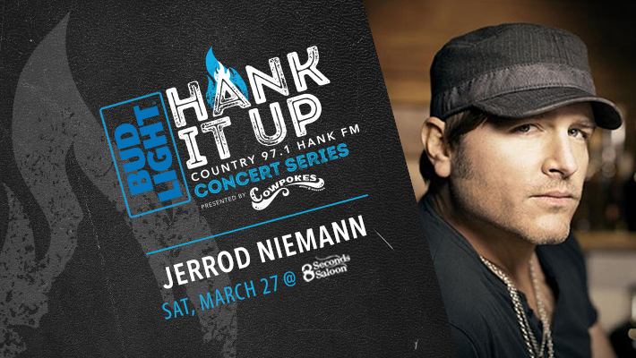 black leather with grey flame icon Bud Light HANK IT UP Country 97.1 HANK FM COncert Series Presented by Cowpokes Jerrod Niemann Saturday MArch 27t at 8 Seconds Saloon Jerrod Niemann looking at camera with black ball cap on black shirt and 2 silver chains
