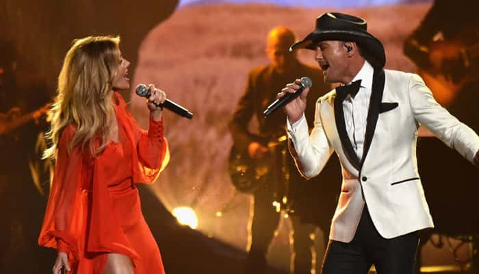 Faith Hill and Tim McGraw perform onstage at the 51st annual CMA Awards