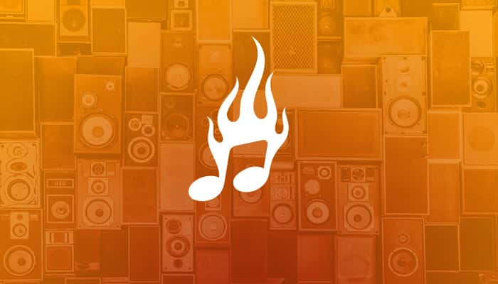 wall of speakers with music note on fire