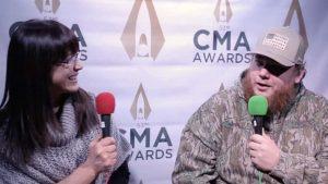 Luke Combs talks with Cara at the CMA Awards