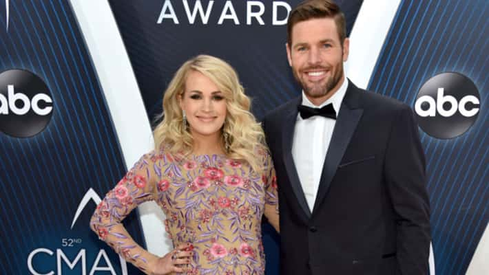 Carrie Underwood and Mike Fisher attend the 52nd annual CMA Awards at the Bridgestone Arena in Nashville
