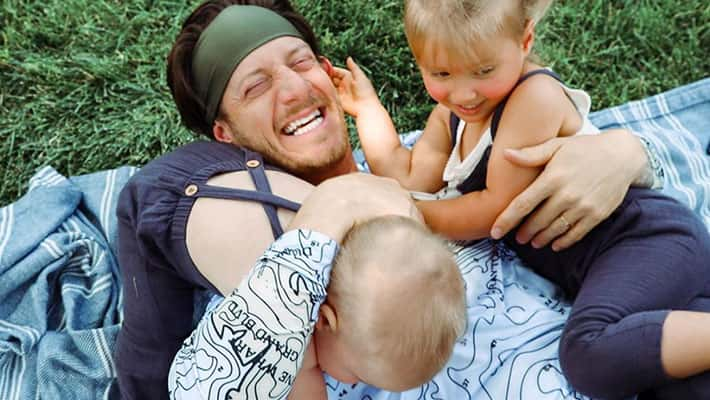 Tyler Hubbard playing with his kids in the yard