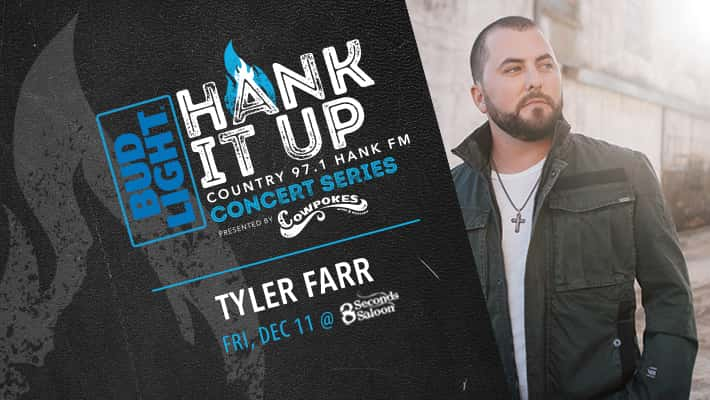 Tyler Farr looking away from camera in white shirt with black jacket and cross necklace Bud Light Hank It Up Country 97.1 HANK FM Concert Series Presented by Cowpokes Tyler Farr Friday December 11th at 8 Seconds Saloon