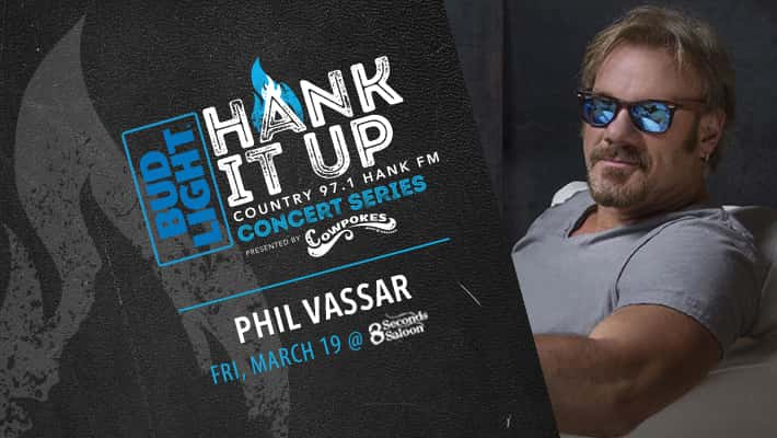 PHil Vassar sitting wearing blue lens sunglasses Bud LIght Hank It Up Country 97.1 HANK FM Concert Series presented by Cowpokes Phil Vassar Friday March 19 at 8 Seconds Saloon