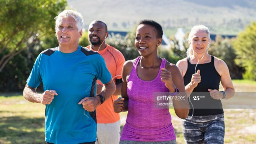 Four adults jogging