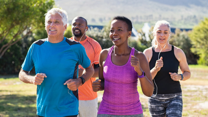 Healthy group of mature people jogging