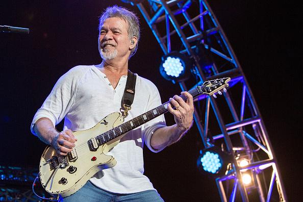 Eddie Van Halen playing guitar in concert