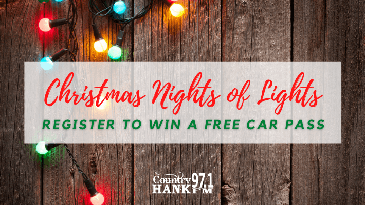 """wood with string of christmas lights """"Christmas Nights of Lights register to win a free car pass"""""""