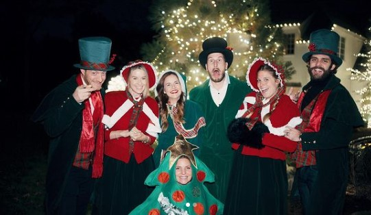 Thomas Rhett, Russell Dickerson, and Tyler Hubbard, and wives out caroling